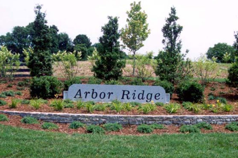 the entrance sign for Arbor Ridge