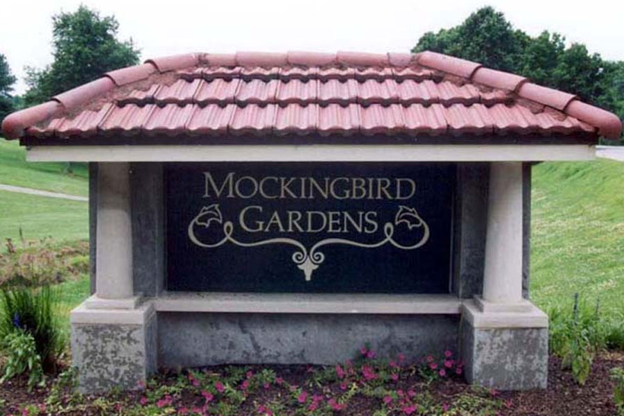 The entrance sign for Mockingbird Gardens